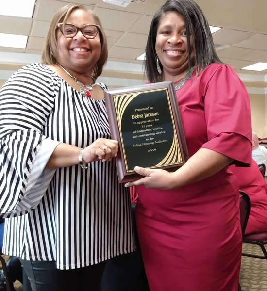 Ms. Clark presenting a 15 years service recognition plaque to Debra Jackson