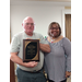 Ms. Clark presenting a 20 years service recognition plaque to David Blosch